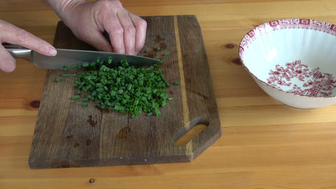 Cut green onions on wooden cutting board Live Action