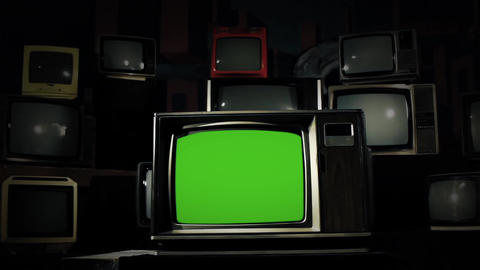 80s Tv Green Screen In The Middle Of Many Tvs. Cold Tone. Dolly Shot Live Action