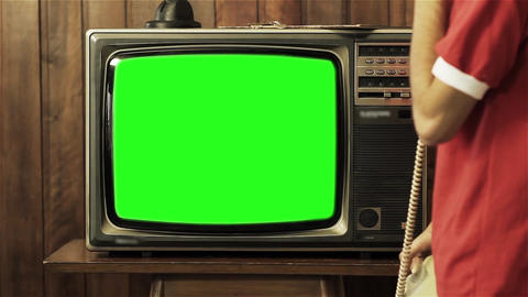 Teenage Boy Talking On Old Phone Near Television With Green Screen ライブ動画