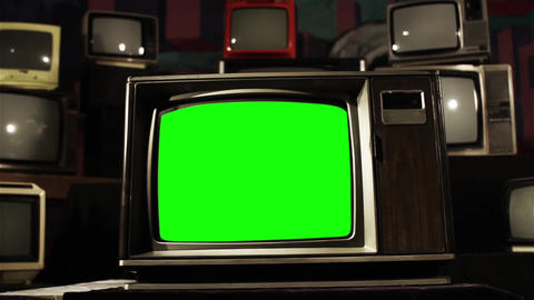 80s Tv Green Screen In The Middle Of Many Tvs. Dolly Shot. Sepia Tone to Color ビデオ