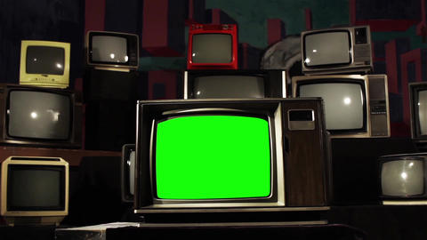 Old Tv with Green Screen In The Middle Of Many Tvs. Dolly Shot Footage