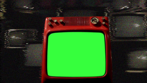Old Red Tv Green Screen In The Middle Of Many Tvs. Noise Live Action