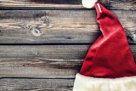 Christmas background, Santa hat, celebration, wooden table. creative, decorative Fotografía