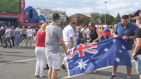 Football fans with the flag of Australia in the fan zone of the world Cup 2018 Live Action