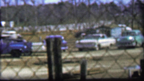 1957: Classic car stock racing infield behind flimsy safety fence Footage