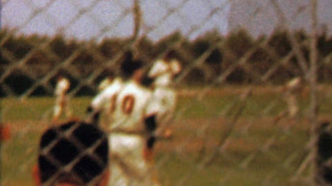 1961: Washington Senators baseball team batting practice behind fence Footage