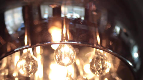 Glass chandeliers located on the ceiling of a local luxury 70 Footage