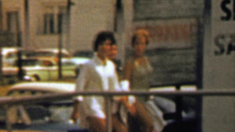 1967: Girlfriends pass Seafood Steak Chops Sandwiches Sundaes sign Footage