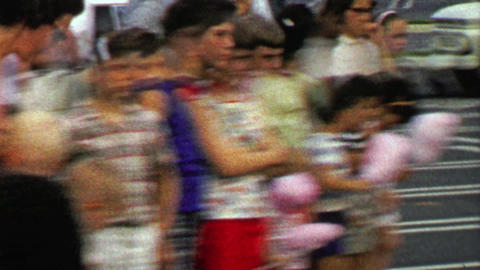 1967: Crowd of kids watch circus performance eating cotton candy Footage