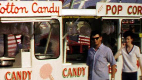 1967: Cotton candy popcorn carnival circus food vendor Footage