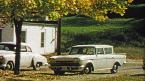 1967: Older woman enters passenger side of car waiting for driver Footage