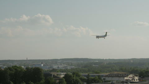 Rear view of twin engine jet airplane landing at the airport GIF
