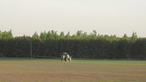 Tractor spray fertilize on field with chemicals in agriculture field Footage