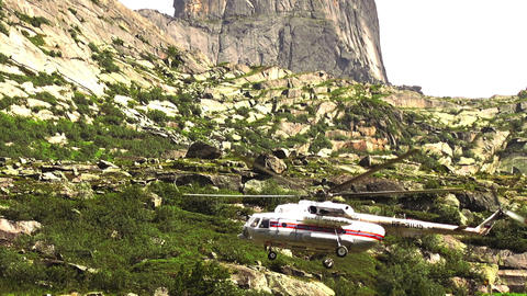 Rescue helicopter fly ower a high rocky mountain ビデオ