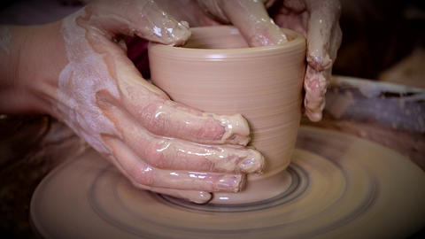 Girl sculpts in clay pot closeup. Modeling clay close-up Live Action