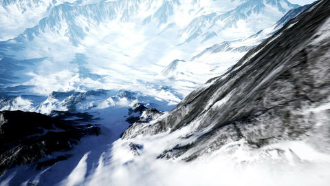 Beautiful Aerial Flight Over Snowy Mountain. Beautiful Winter Nature and Clouds Animation
