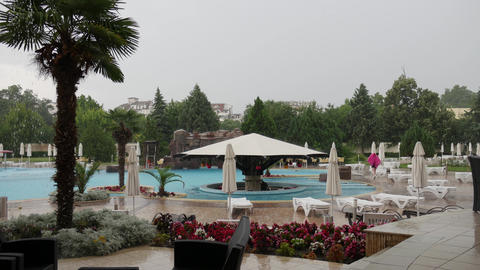 Heavy rain in swimming pool complex Archivo