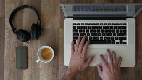 Freelancer working on laptop computer - top-view workspace with coffee, GIF