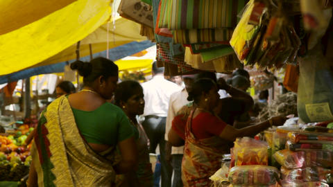 Market place,stall with vegetables. People shopping, looking at vegetables in Footage