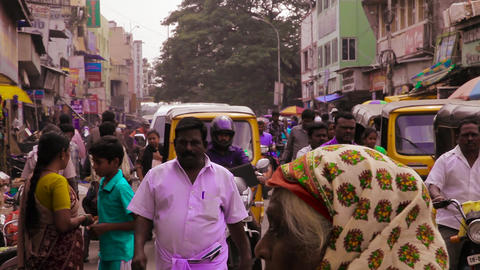 Crowds of people visit a popular shopping street in India. Busy traffic street Live Action