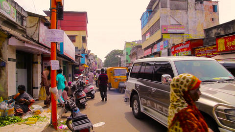 A busy and candid street scene in a market district of Chennai, India. Busy Footage