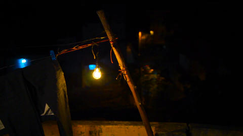light bulb In the old village house. Exterior shot of house at nighttime Footage