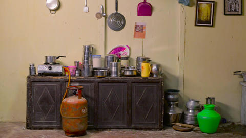 Establishing shot of house kitchen interior with accessories, gas, water pot Live Action