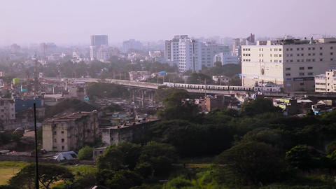 Aerial view of train over a busy metro city in India Footage