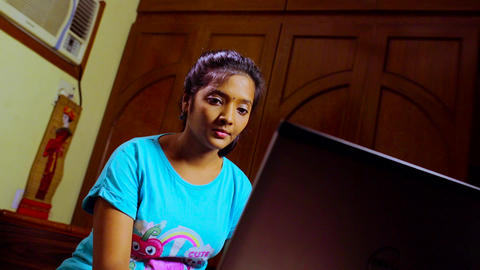 Stressed woman using laptop at home Footage