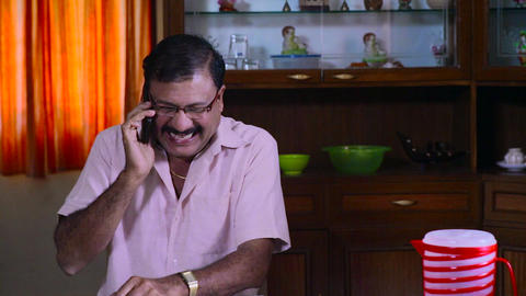 old man speaking on the mobile phone, happy senior man speaking on smart phone Footage