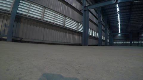 Big storage room. Inside of empty warehouse Live Action