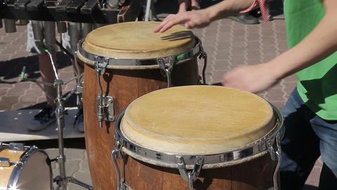 The street drummer plays the Conga drums Footage