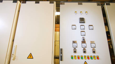 cases with dashboard and danger warning sign at electrical station Footage