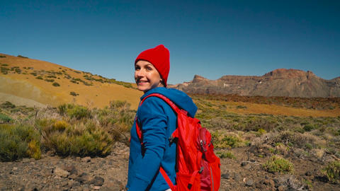 Follow me - happy young woman in red hat with backpack pulling guy's hand. Hand ビデオ