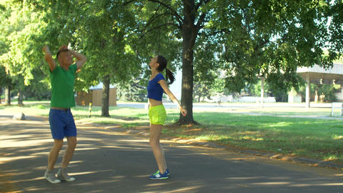 Couple runners celebrating after finishing workout Footage