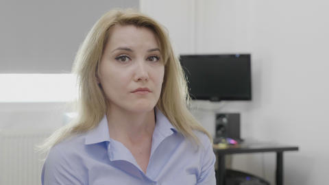 Overworked young businesswoman looking stressed and exhausted at office feeling Live Action