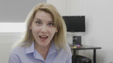 Beautiful young female employee expressing surprise and jaw dropped shocked Footage
