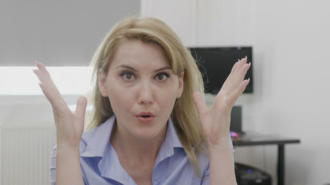 Female entrepreneur doing mind blown shocked reaction and gesture Footage
