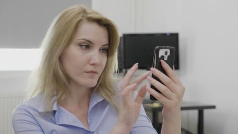Jaw dropped office woman surfing on social media network using smartphone Live Action