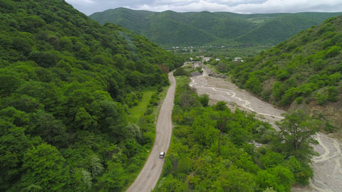 Aerial View of a Car Traveling on a Gravel Road Footage