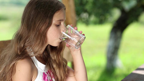 Girl drinks water from a glass Footage
