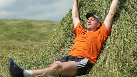 Man lying on a haystack. Physical and mental relaxation Footage