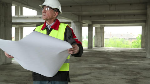 Master builder with design drawings at construction site Footage