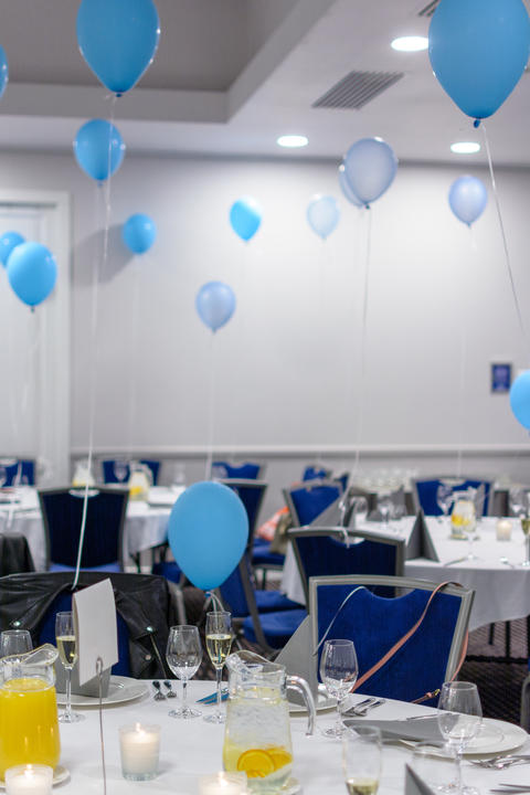 Party wedding or prom with blue coloured balloons and copyspace sign on table Photo