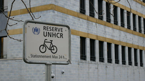 Bike parking in front of the main entrance of the UNHCR headquarters in Geneva Live Action