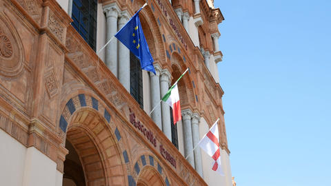 Flags wave on the facade of the Milan Natural History Museum Footage