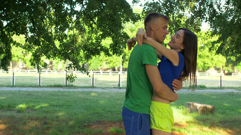 Joyful sporty couple meeting during outdoors workout Footage