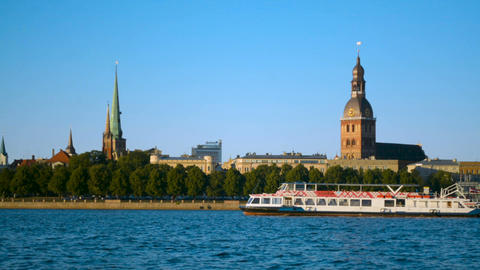 Riga Old Town panorama with big cruise ship cutter passing by on Daugava river Footage