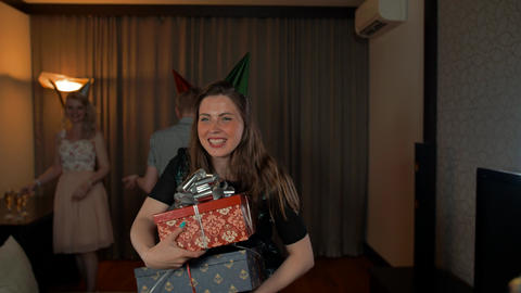 Young handsome woman getting many presents from her friends Footage