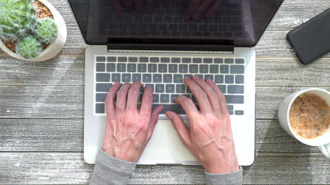 Person typing on laptop computer Live Action